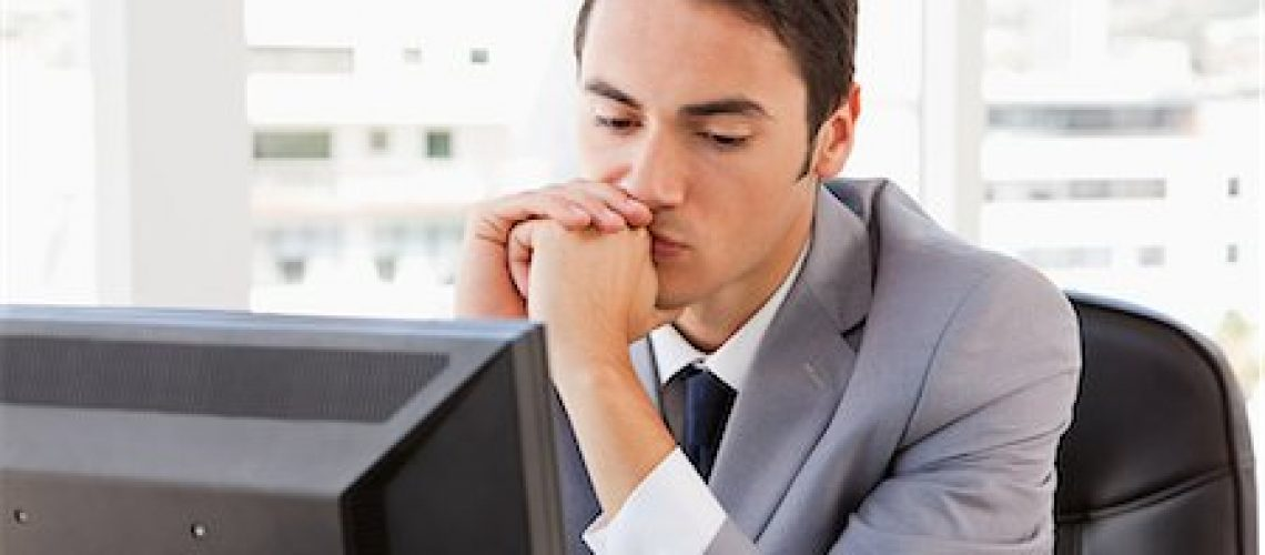6109-06005527 © Masterfile Royalty-Free Model Release: Yes Property Release: Yes Bored businessman in front of his computer in a bright office